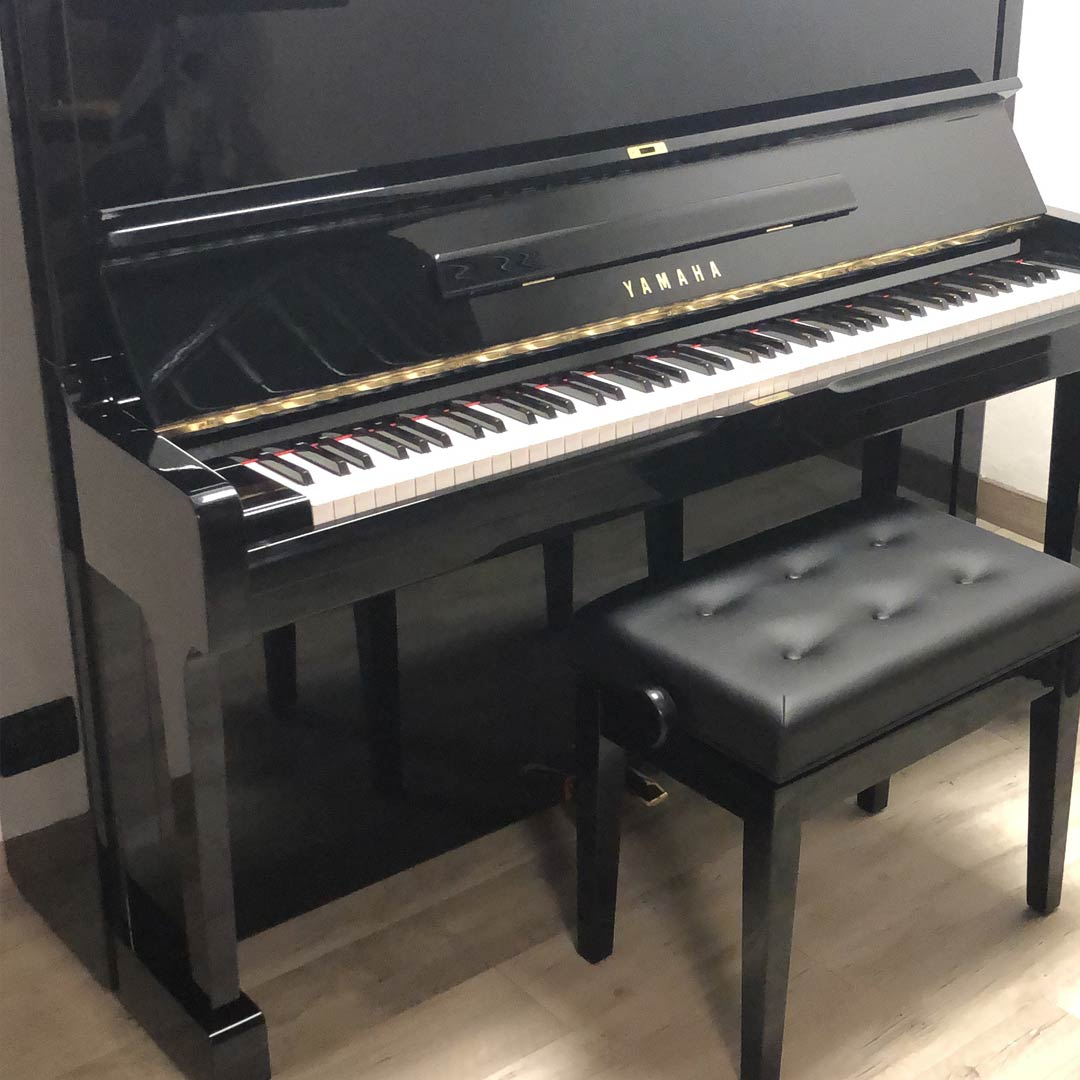 Black Upright Piano Made By Yamaha With Leather Stool