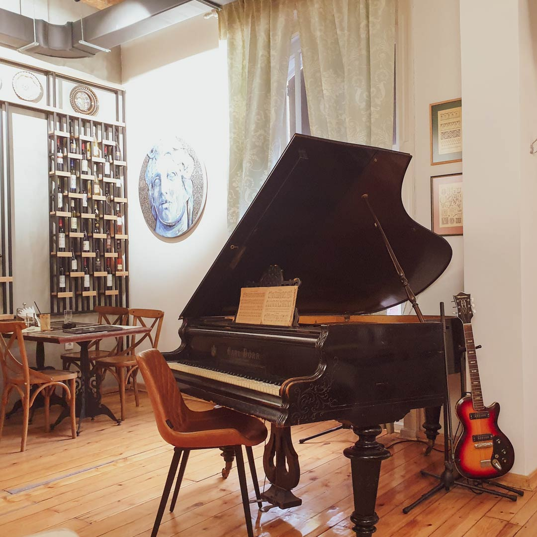 Brown Baby Grand Piano With Guitar