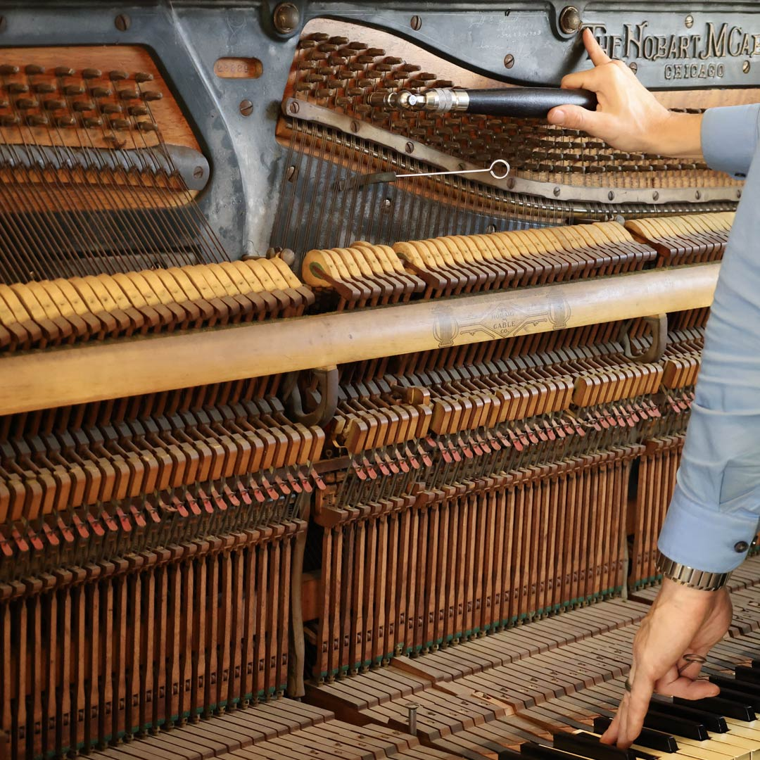 Upright Piano Being Tuned